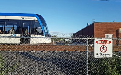 LRT drives past location of former unofficial crossing for Traynor-Vanier residents